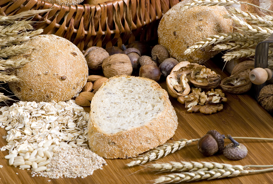 bread, grains and nuts on wooden board