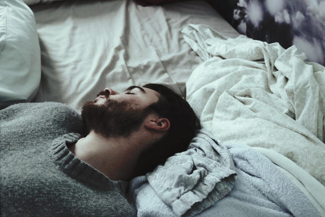 Man asleep or resting on bed masturbation and testosterone