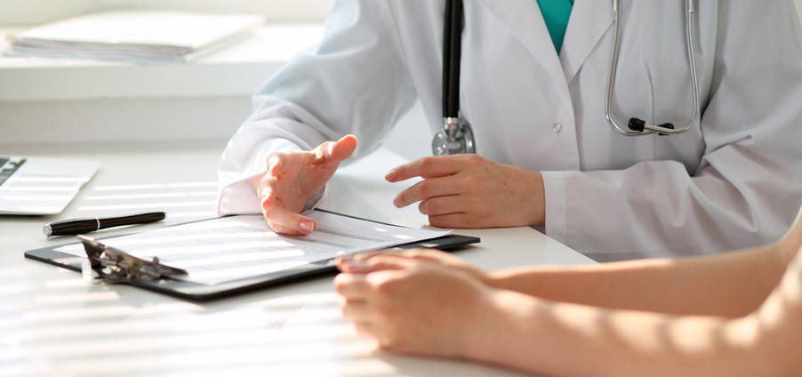 doctor advises young woman patient