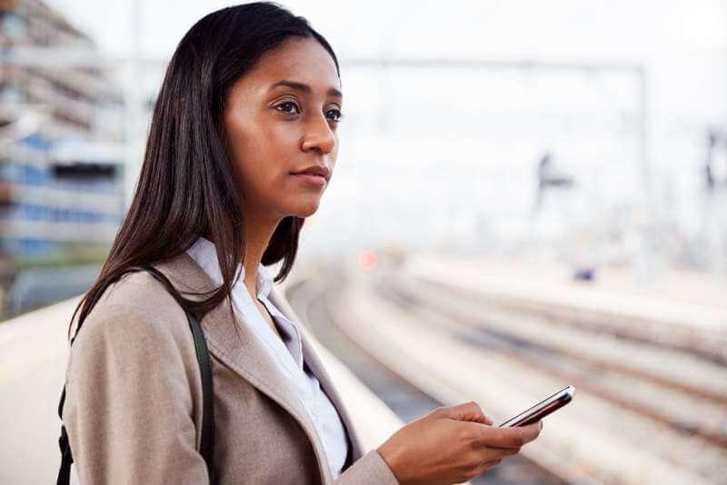 businesswoman-standing-on-railway-platform