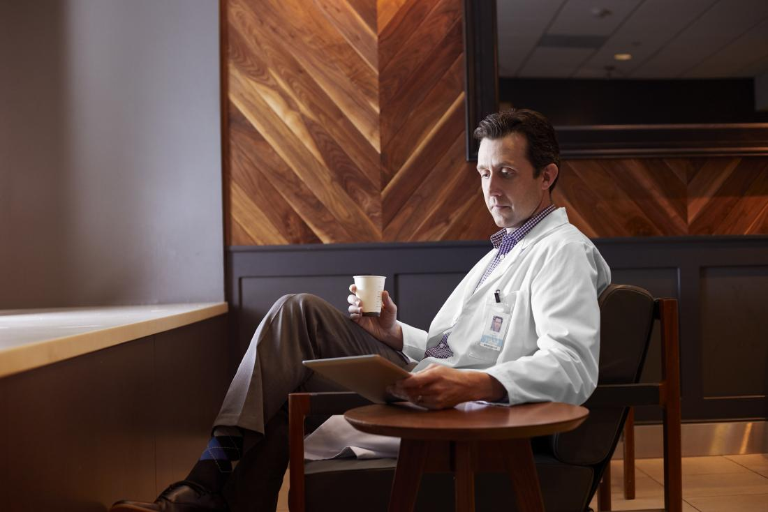 Doctor reading medical journal