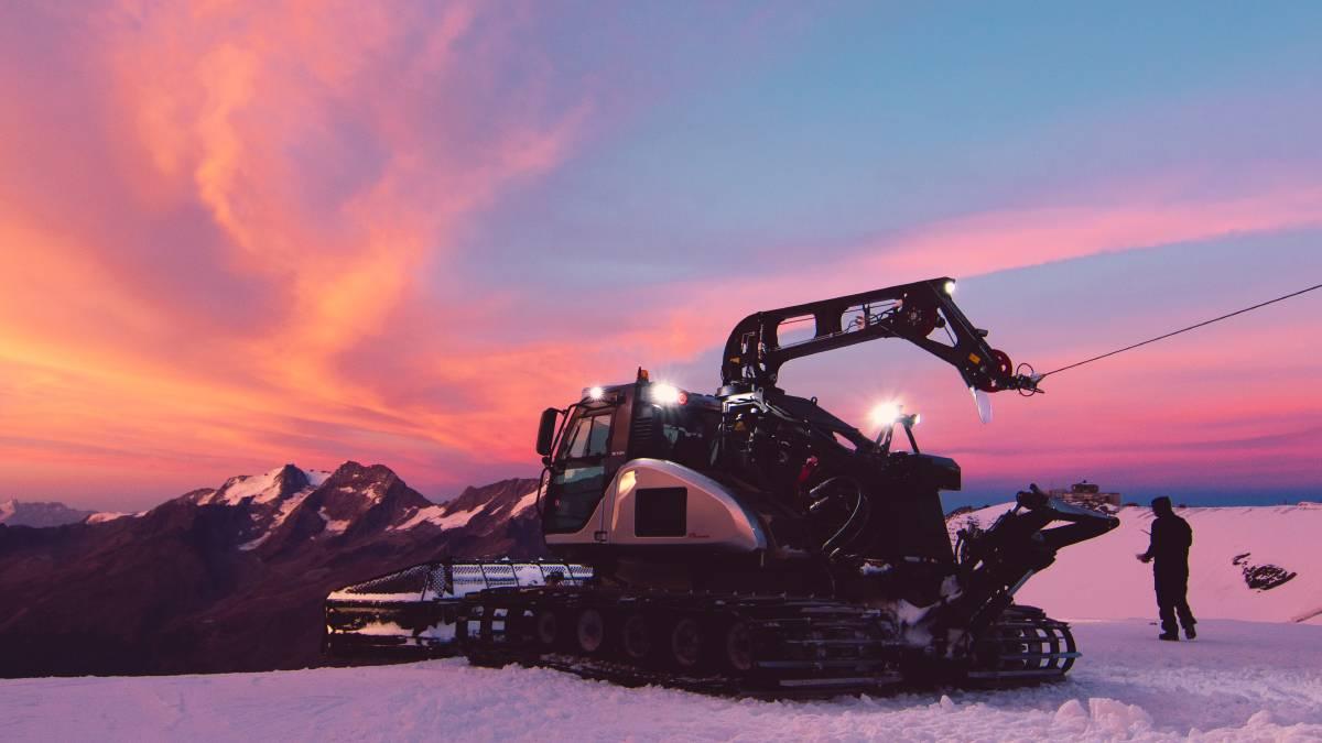 A snowcat at work building a terrain park in Switzerland