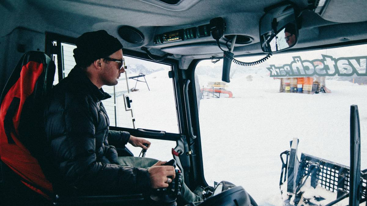 Terrain park builder Charles Beckinsale behind the controls of a snowcat in Switzerland. Picture: Stomping Grounds