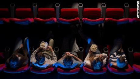 A group of most assuredly platonic friends take in a movie.