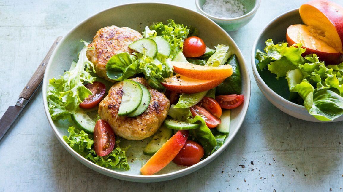 Paleo chicken burger with salad
