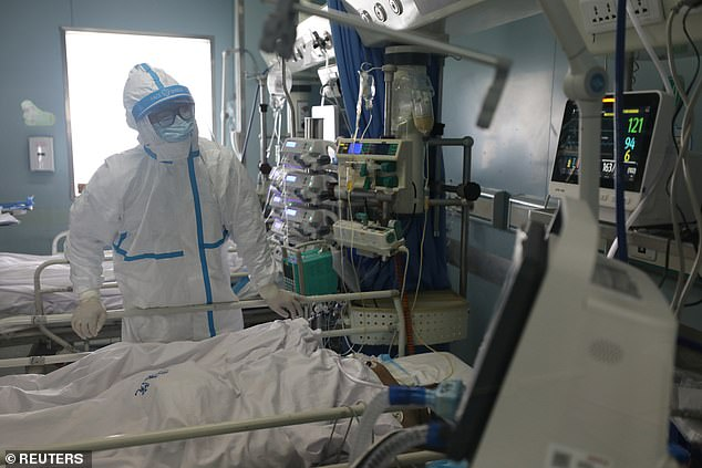 More than 60,000 people have now been infected with the coronavirus in China. A medical worker is pictured in the intensive care unit at Jinyintan Hospital in Wuhan