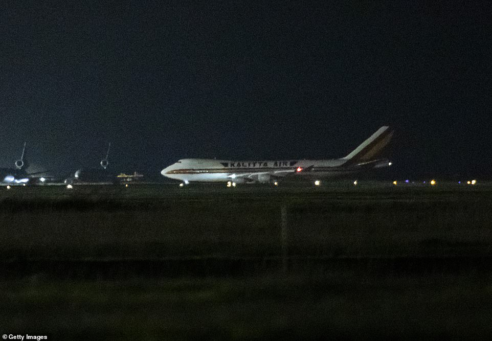 One of two planes carrying 340 Americans back to the US from Japan where they spent almost two weeks under coronavirus quarantine on board the Diamond Princess cruise ship has landed at Travis Air Force Base in California (pictured)