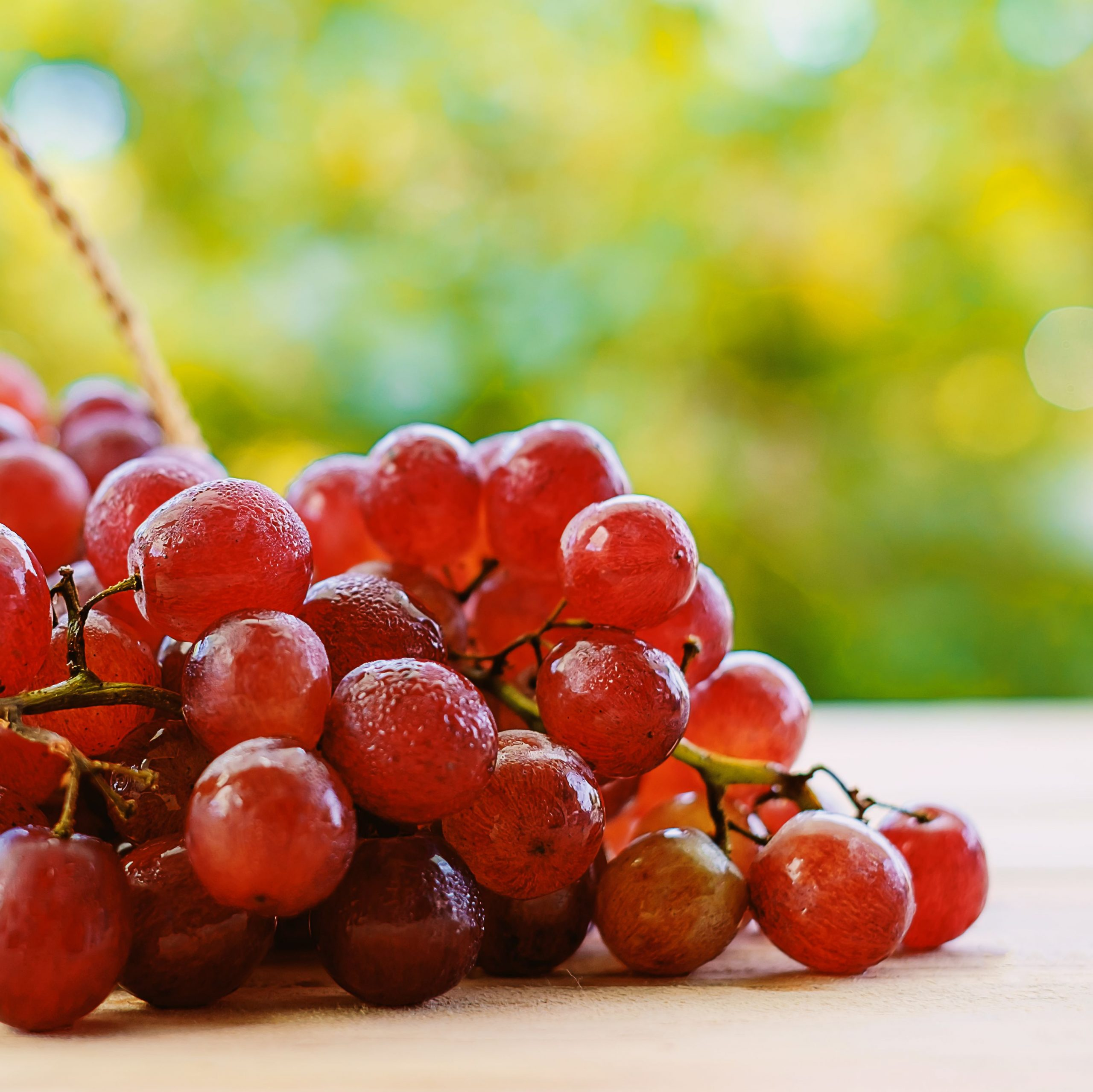 Close-Up Of Red Grapes On Table