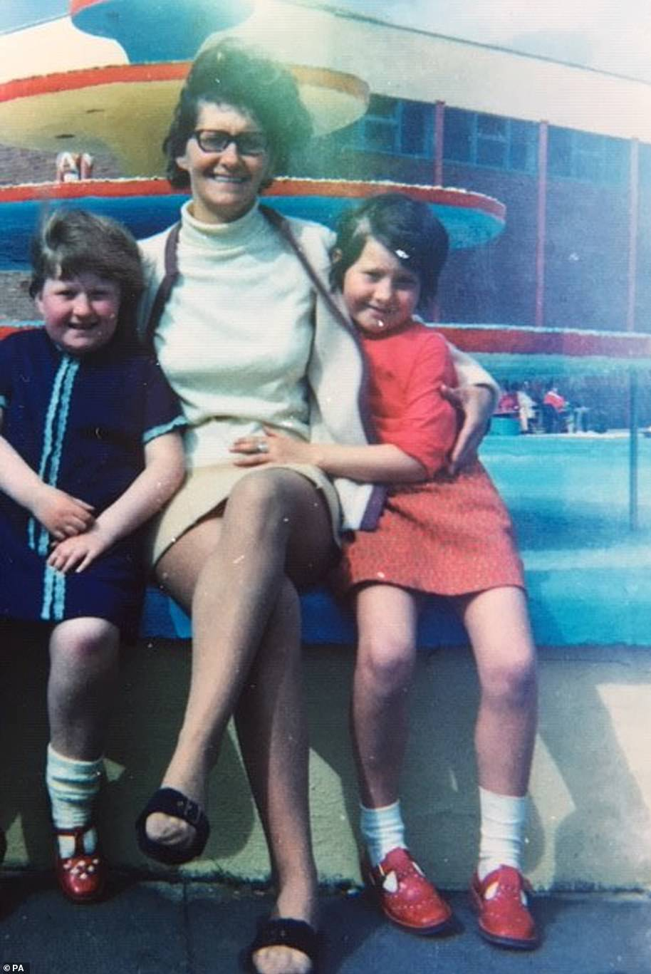 Julie Ding (pictured, right, as a child with her mother Roberta and late sister Susan) fears she will not be able to be at her dying mother's bedside because she was banned from visiting her nursing home