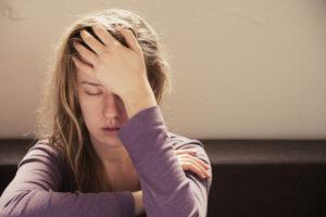 woman who is feeling fatigue