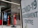 A nurse guides people being tested for COVID-19 outside a hospital in Toronto December 10, 2020.