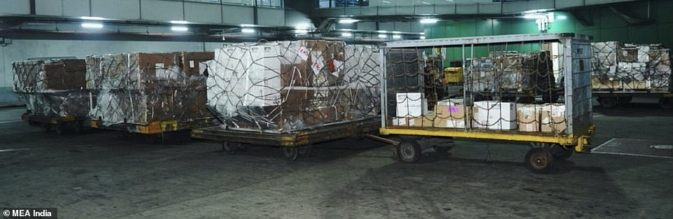 Overseas medical aid including items sent by the UK wait on trucks after arriving at Delhi airport today
