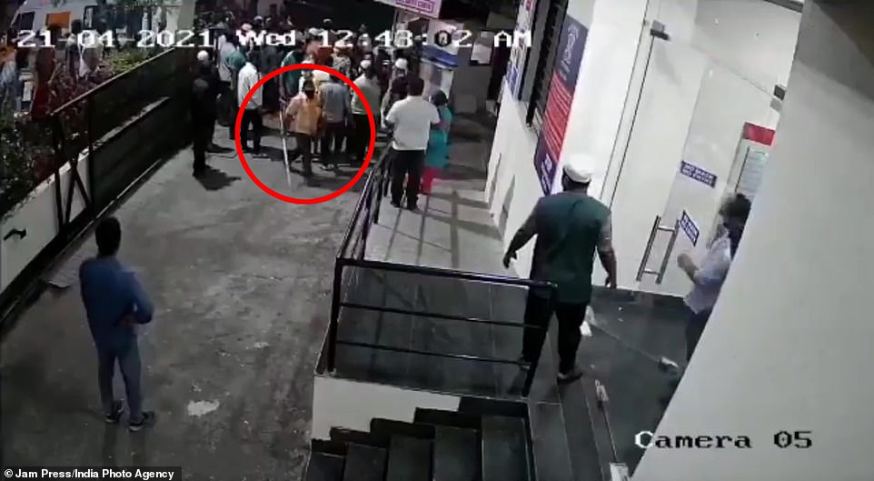 CCTV taken outside a hospital in Pune last week revealed the moment 15 to 20 relatives of someone who died from Covid attacking a doctor using a metal pipe