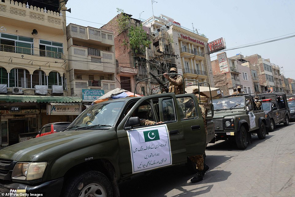Army, Rangers and police personnel patrol the streets of Lahore in Pakistan, just across the border from India, as part of a drive to prevent the spread of Covid