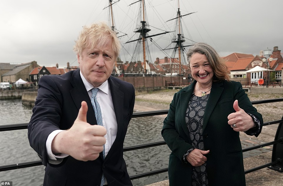Boris Johnson (pictured celebrating the Tories' by-election win on Jacksons Wharf with Hartlepool MP Jill Mortimer this morning) has pledged 'absolutely ruthless' tracking of India's mutant Covid strain after health chief today officially declared it a 'variant of concern'