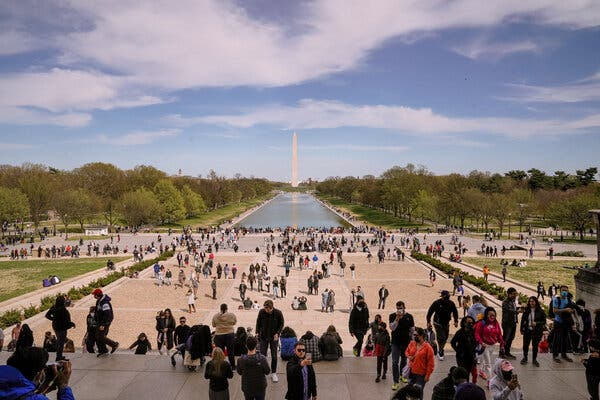 Crowds on the National Mall in April. Resistance to the vaccines is a main reason the United States is unlikely to reach herd immunity, but it is not the only one.