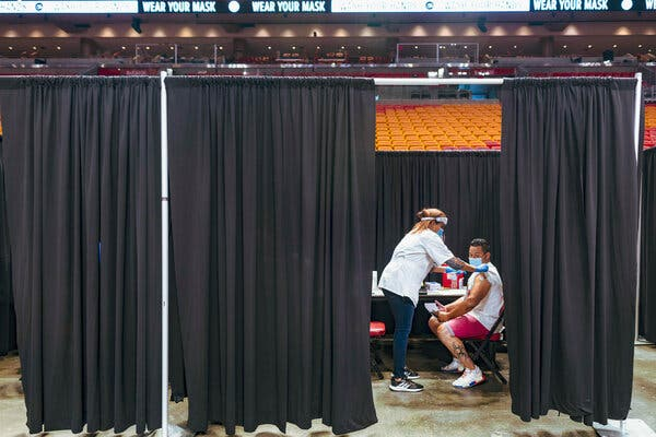Vaccinations at the American Airlines Arena in Miami on Thursday. Though there is consensus among scientists and public health experts that the herd immunity threshold is not attainable, it may not be all bad news.